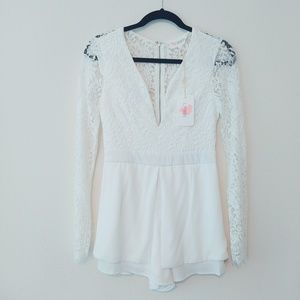 NWT. L'ATISTE White Lace Romper. Size Medium